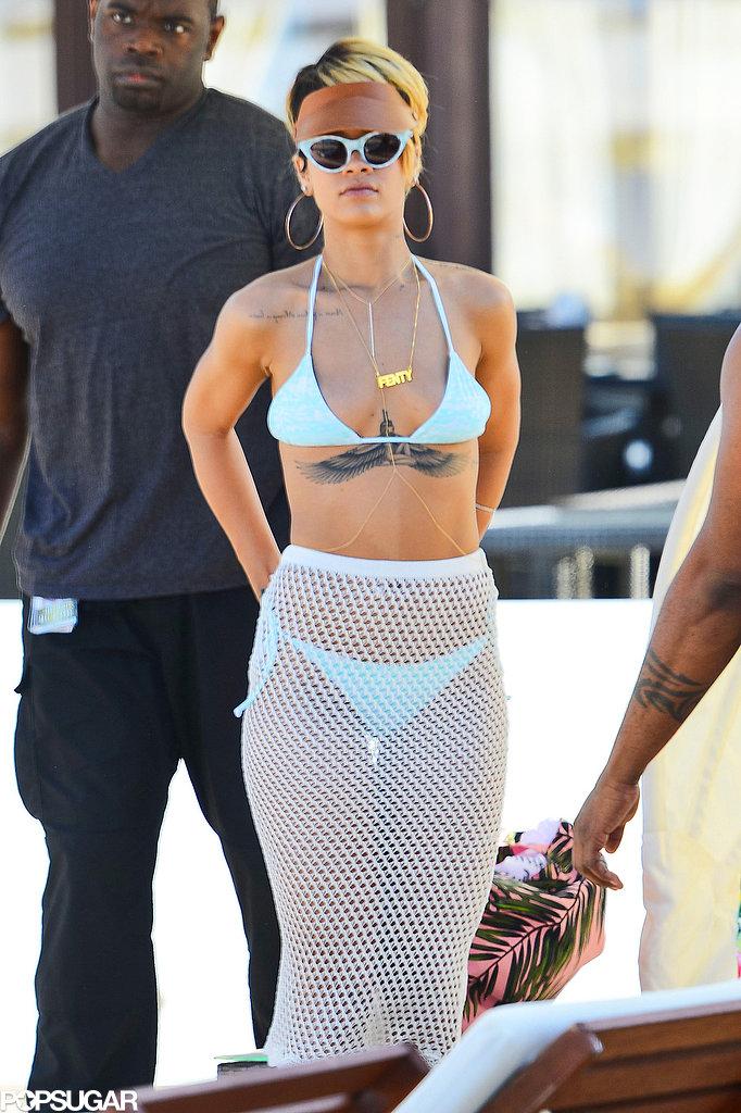 Rihanna wore a blue bikini and fishnet skirt.