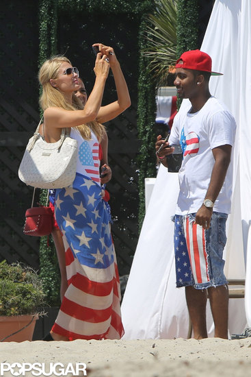 Paris Hilton took out her phone during a Fourth of July fete in 2013 to snap a photo.