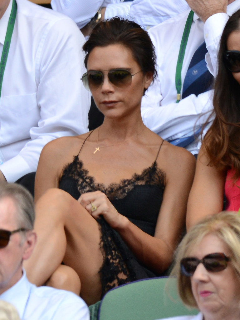 Victoria Beckham turned heads in a lace dress as she took her seat at Wimbledon in London.