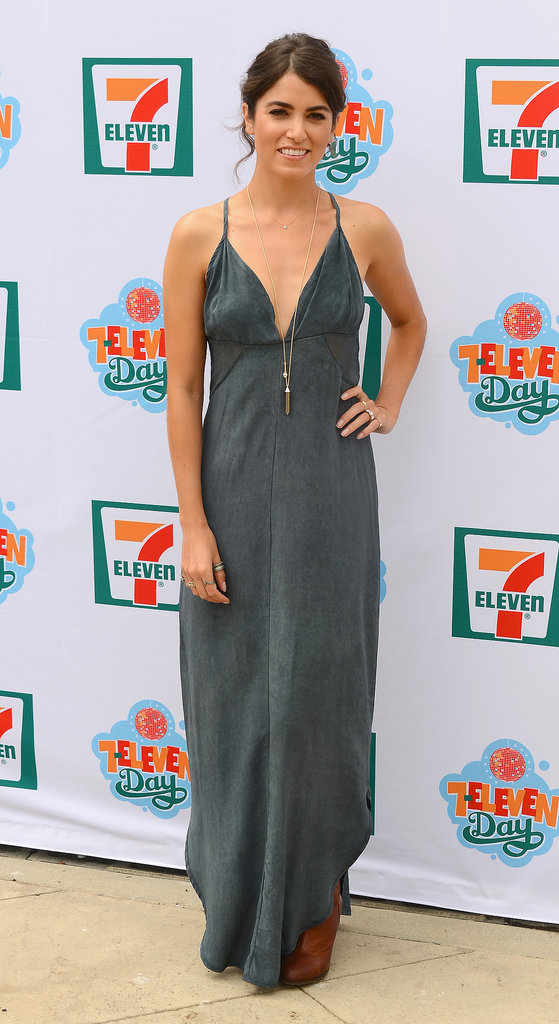 Nikki Reed celebrated 7-Eleven's 86th birthday bash in this Gypsy05 cutout maxi dress ($275) and an array of delicate gold jewels.
