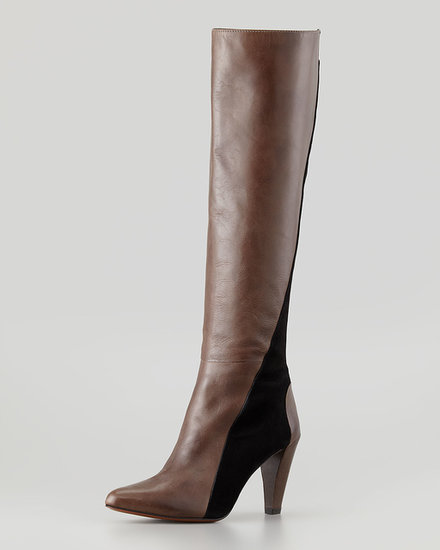 A simple slice of black livens up knee-high leather boots ($575).