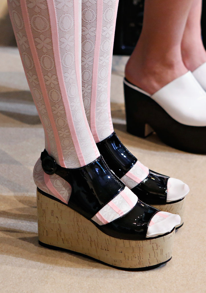 Striped stockings and patent leather platforms? We could totally see this look on Chloë!