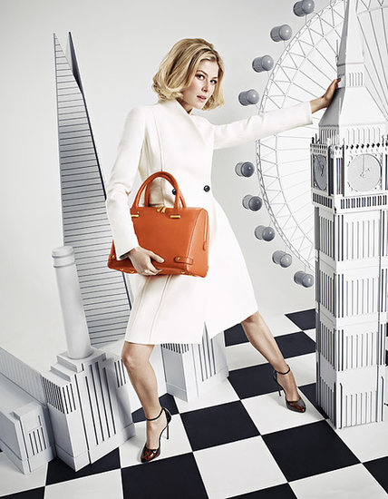 "Rosamund Pike worked closely with the LK Bennett design team for six months to create her Autumn 2013 collection. ""I think having a handbag is about feeling that you are holding a little bit of luxury and hopefully that is what this bag will offer,"" she said.  Source: LK Bennett"