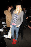 Poppy was equal parts preppy and downtown cool in a striped tee, blazer, fedora, and statement heels at Fashion Week Fall '13 in London.