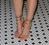 Sophia's nude ankle-strap sandals featured cool silver chain straps that gave them edge.