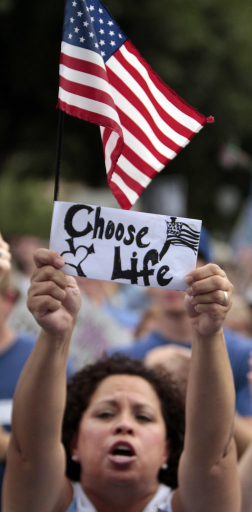 A pro-life supporter held up a sign outside the Texas Capitol building.