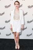 Emma Roberts chose a striking combination with white and gold on Persol's black carpet.