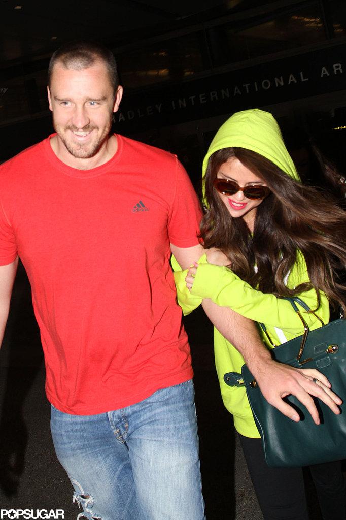 Selena Gomez held onto her stepdad's arm when she landed in LA.