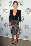 Heidi Klum may have kept her arms and legs covered up, but she made sure to show off her sultry cleavage in a plunging number at the Made in NY Awards.