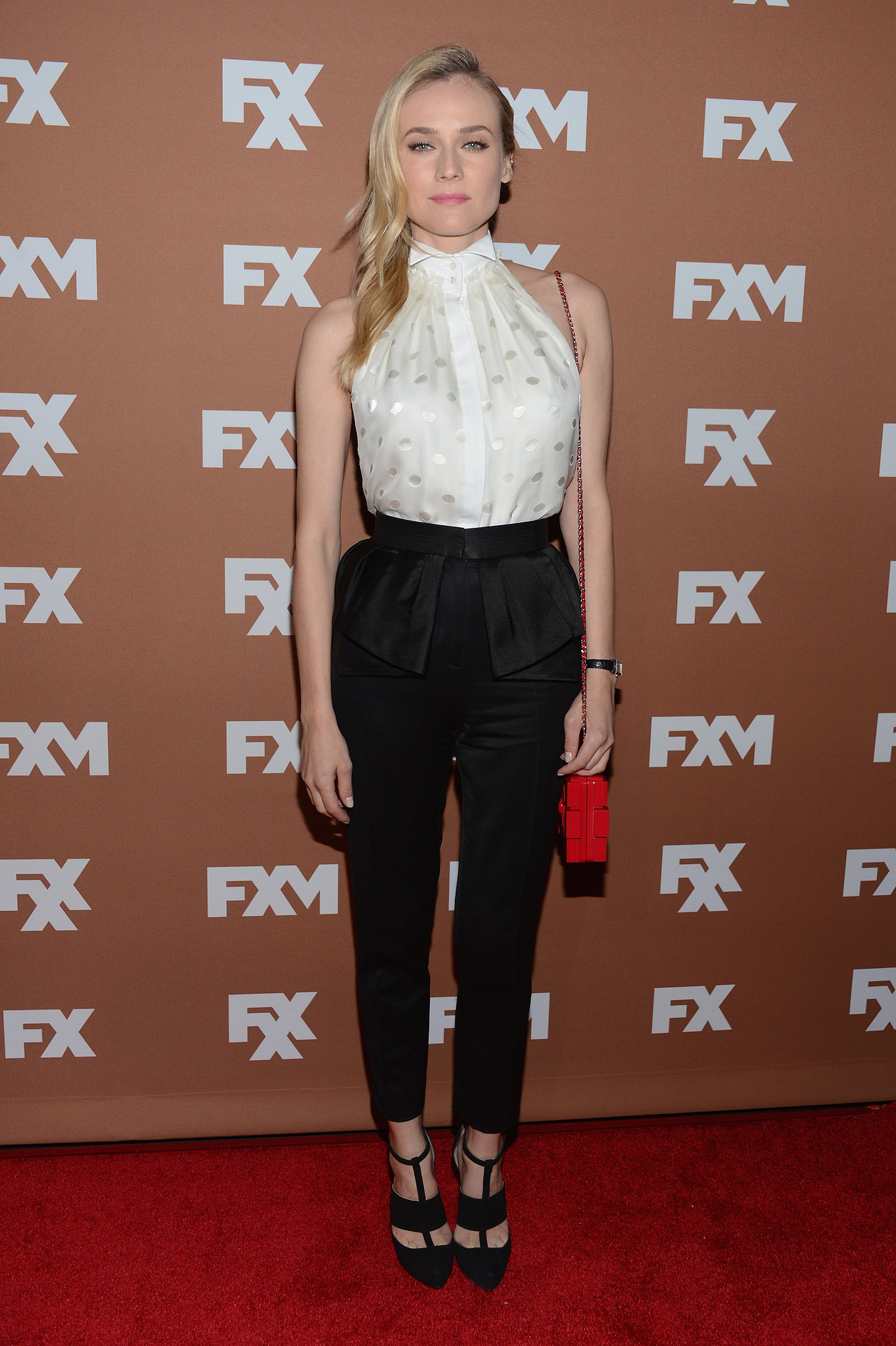 "Diane ""Wu-ed"" us in a perfectly constructed pairing: white collared Jason Wu blouse and peplum-detailed black trousers, at an FX upfront bowling event earlier this year. Her strappy black pumps and red mini Chanel bag were the icing on this fashion-forward look."