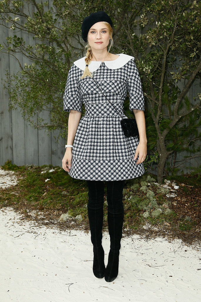 Diane Kruger showed her support for friend Karl Lagerfeld donning Chanel for the house's couture show earlier this year. The German actress wore a schoolgirl-inspired dress partnered with over-the-knee boots, a chic black beret, and classic shoulder bag.