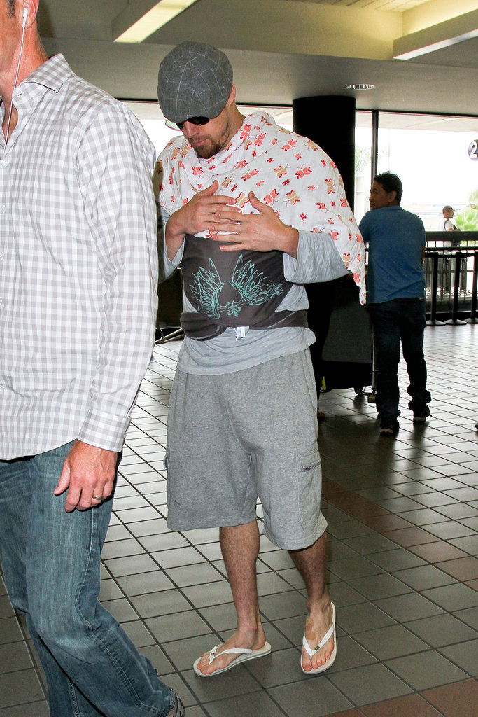 Channing Tatum kept a close hold on his tiny baby daughter Everly as he and his wife Jenna made their way through LAX on July 7.