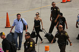 Angelina Jolie and her son Maddox made their way to their private jet as they left Hawaii on July 10.