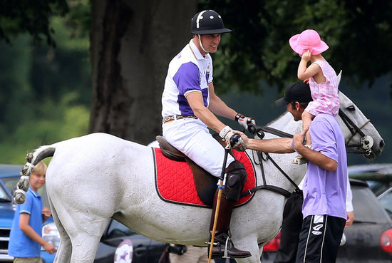 Prince William talked with a dad and his little girl at a polo match.