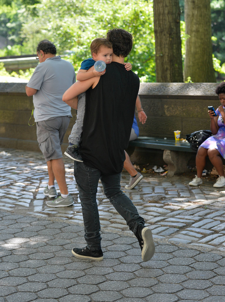 Orlando carried a tired Flynn through Central Park, NYC, in July 2013.
