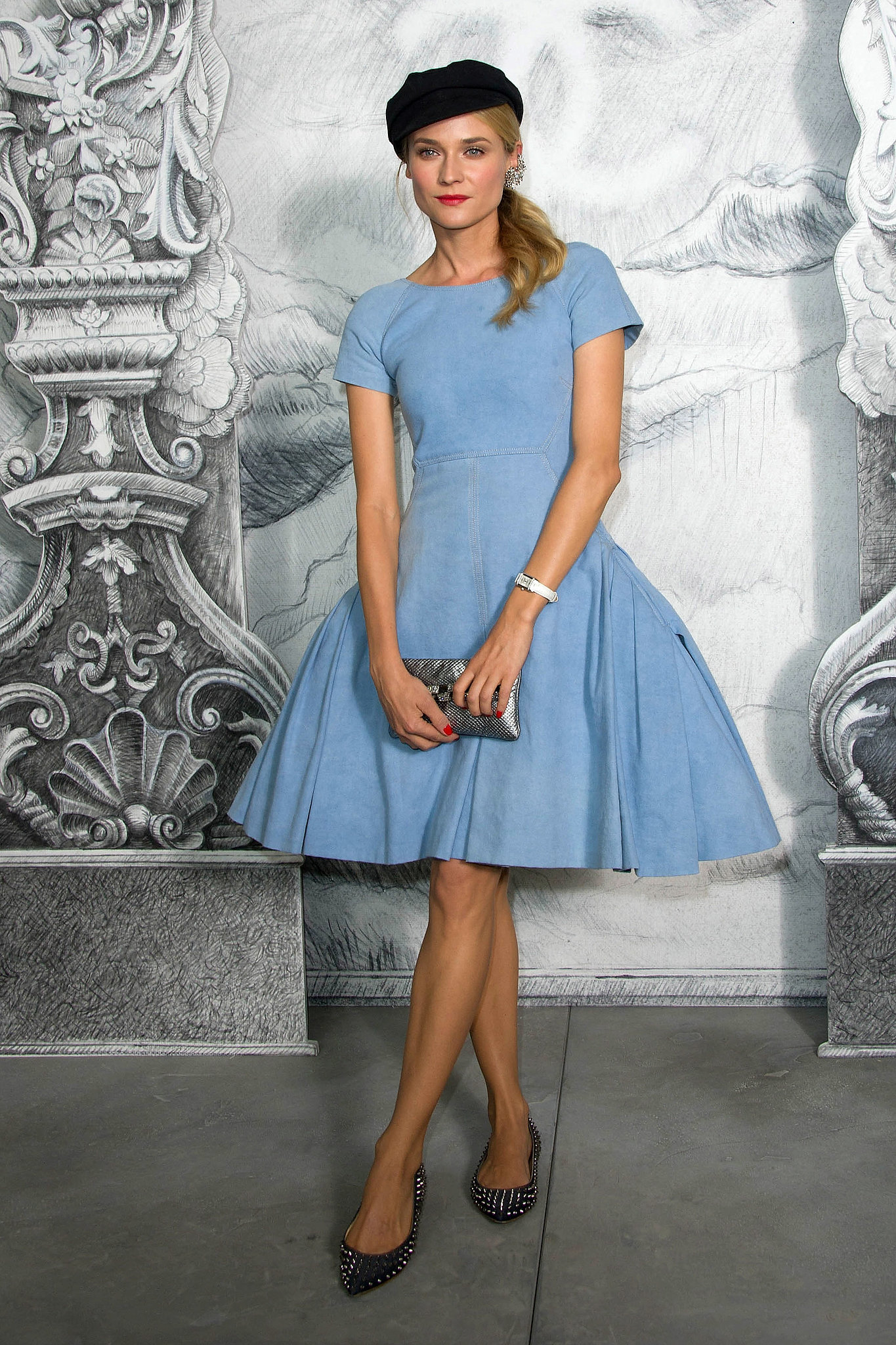 Diane went for classic Parisian chic in a blue Chanel Resort '13 dress, spiked Christian Louboutin flats, and a black newsboy cap for the Chanel Haute Couture show in July.