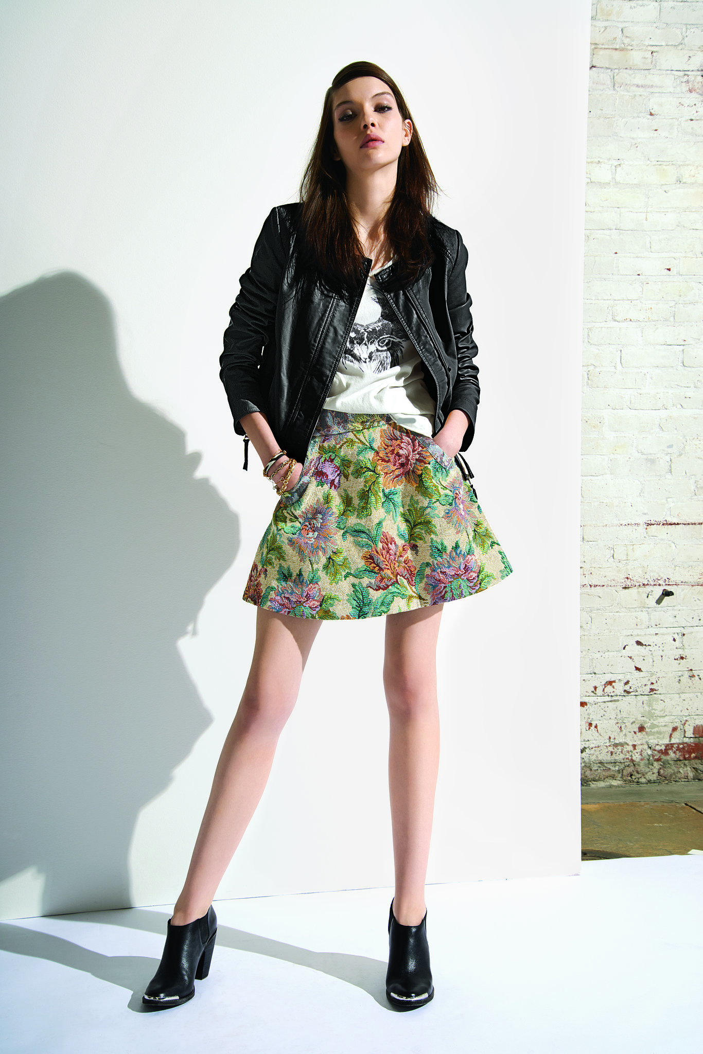 Love this styled look from Free People? It's all on sale! The girliness of the floral skater skirt ($60, originally $98) and lace t-shirt ($50, originally $78) is topped off nicely by the vegan leather jacket ($130, originally $198).