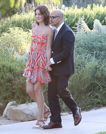 Felicity Blunt went flirty in an orange printed, flowy minidress and low wedge sandals at Jimmy Kimmel's wedding in July. Follow suit by matching a fun printed number with strappy wedges.