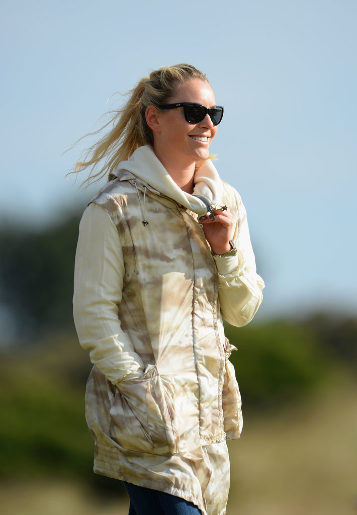 Lindsey Vonn watched Tiger Woods play a practice round for the 142nd British Open Championship.