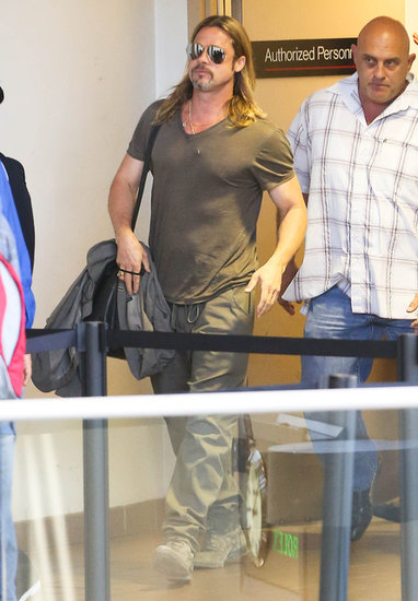 Brad Pitt made his way through security at LAX.