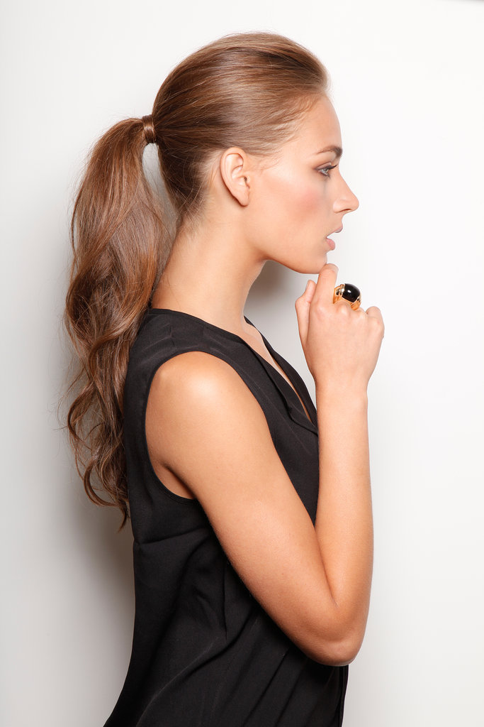 Rachel paired this voluminous ponytail with the sleek Black Block Ring ($72) for a simple and classic look. If you want to re-create this look at home, then start off by teasing your hair near the roots and loosely curl the ends for a subtle boost of volume.