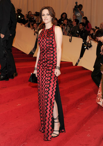 Owning a satin, floor-length, printed Proenza Schouler gown with lace-up sandals and moody eye makeup, Stewart evoked a vampire glamour unlike anyone before her at the 2011 Met Gala.