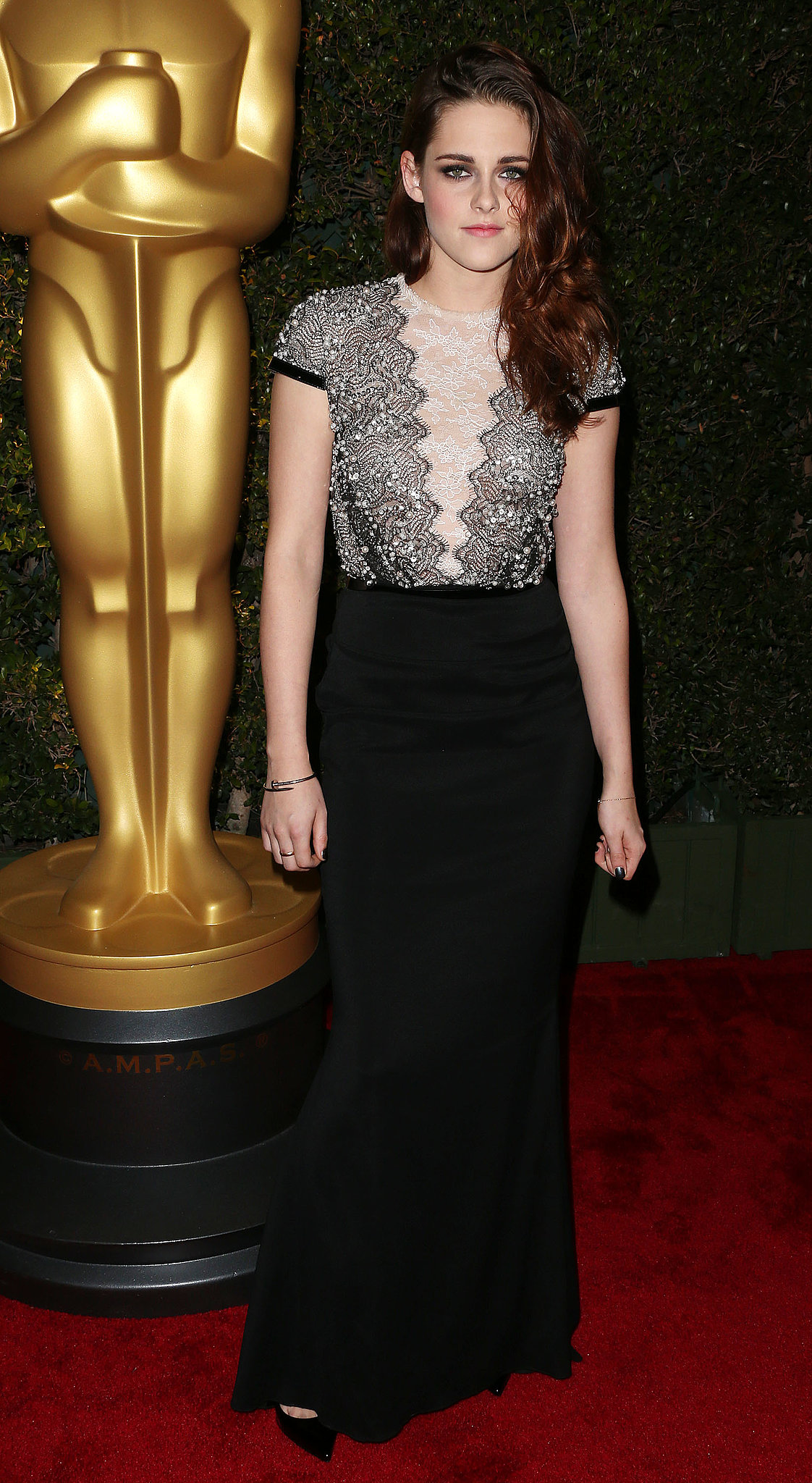For an award ceremony in December 2012, Stewart chose a lace- and sequin-embellished Talbot Runhof gown and finished it off with classic black pumps and a dainty Cartier bracelet.
