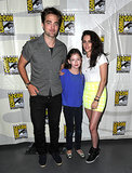 Robert Pattinson and Kristen Stewart posed with their onscreen daughter Mackenzie Foy at the panel for Breaking Dawn: Part 2 in 2012.