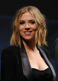 Scarlett Johansson posed onstage at the panel discussion for Captain America: The First Avenger during the 2010 convention.