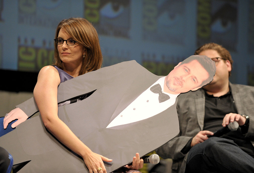 Tina Fey couldn't keep her hands off Megamind costar Brad Pitt's cardboard cutout during the animated movie's panel in 2010.