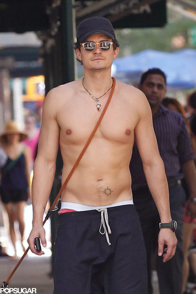Orlando Bloom went shirtless while walking his dog in NYC on Tuesday.