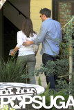 Ben Affleck guided Jennifer Garner into a building.