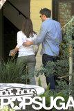 Ben Affleck guided Jennifer Garner into a building.