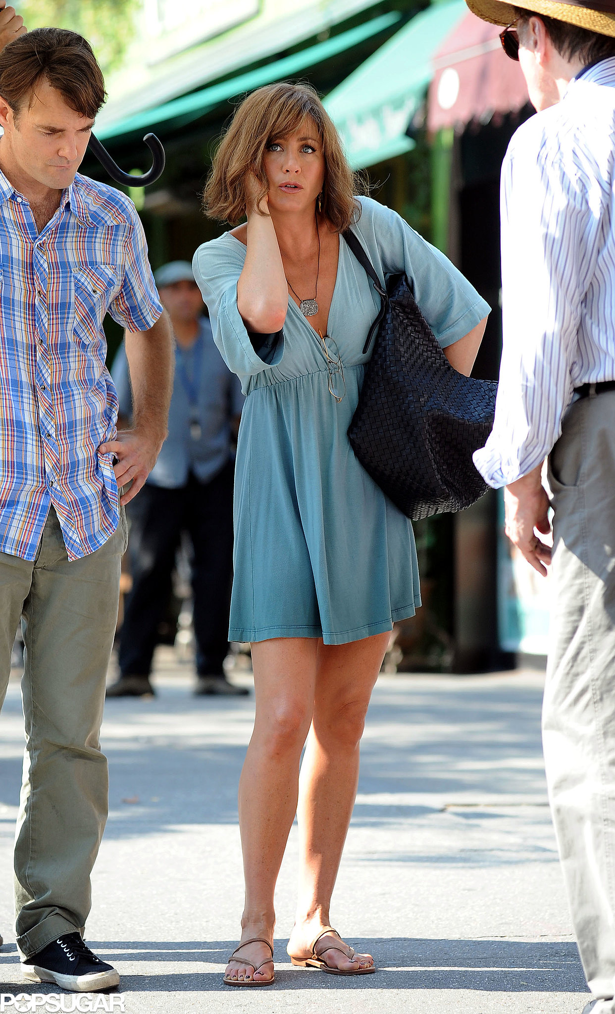 Jennifer Aniston wore a short green dress on July 17.