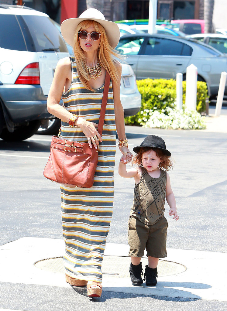 Still not showing even the hint of a baby bump, Rachel grabbed gelato with son Skyler in Malibu. She looked relaxed in a striped maxi dress, a white wide-brim hat, a crossbody bag, and, of course, her signature gold baubles.