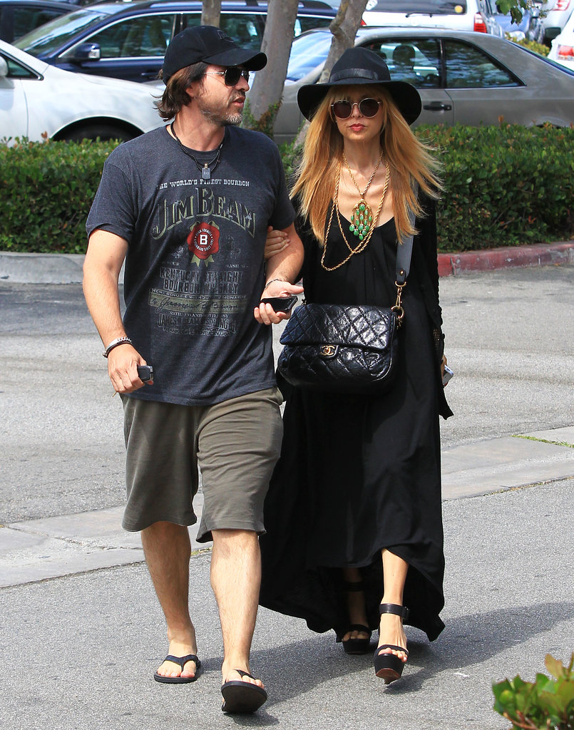 Rachel hung out with husband Rodger in yet another black maxi dress, accessorized with a black hat, round sunglasses, and a multistrand gold and jade necklace.