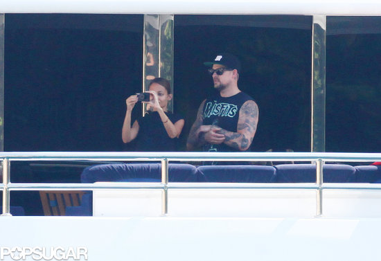 Nicole Richie and Joel Madden snapped photos from their balcony.