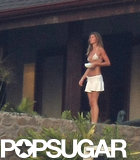 Gisele stepped outside in a white bikini top before her Costa Rica wedding with Tom Brady in April 2009.