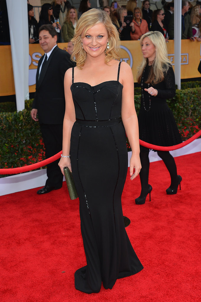 Amy delivered another sexy look, this time in a curve-hugging black  Oscar de la Renta gown at the SAG Awards this year.