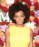 Solange Knowles is known for her love of bright colours, and she didn't disappoint, wearing a neon pink lip hue with her signature bold brows and afro at a Max Mara event.