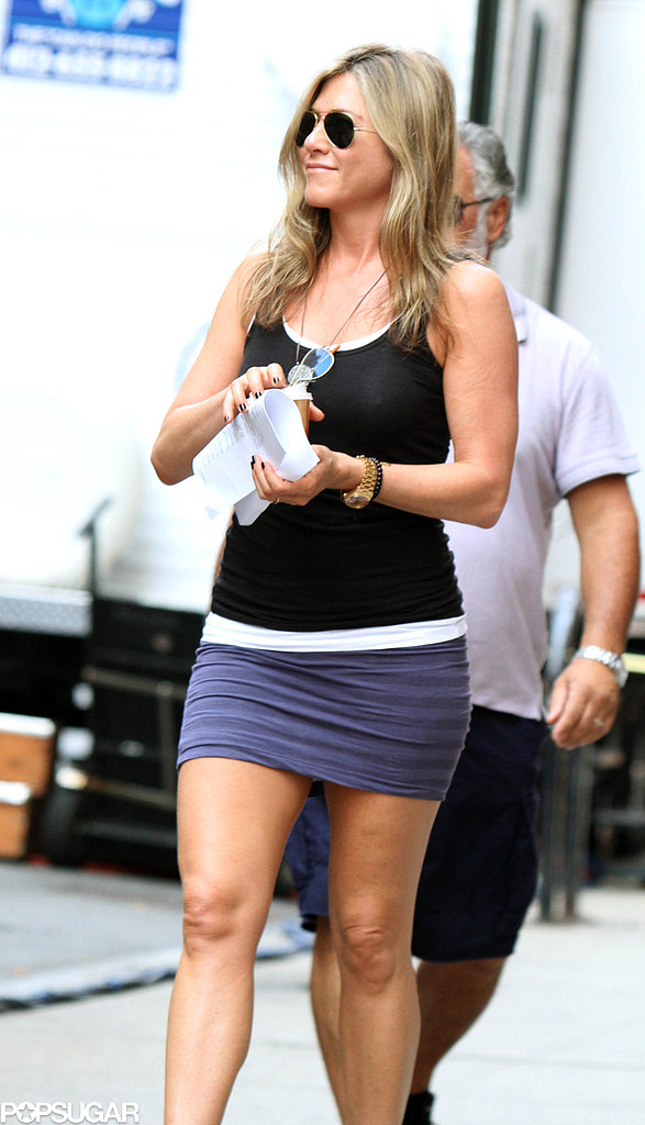 Jennifer Aniston rocked a purple miniskirt and black tank top on the set of Squirrels to the Nuts in NYC on Friday.
