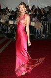 "Hitting the 2006 Met Gala red carpet in a satin fuchsia gown, featuring peek-a-boo netting and floral embroidery, Bündchen affirmed her model nickname, ""The Body."""