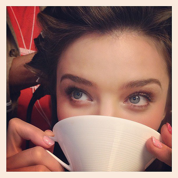 Miranda Kerr sipped on her tea while she had her hair and makeup done during a promo tour in Japan. Note the nails? Very cool. Source: Instagram user mirandakerr