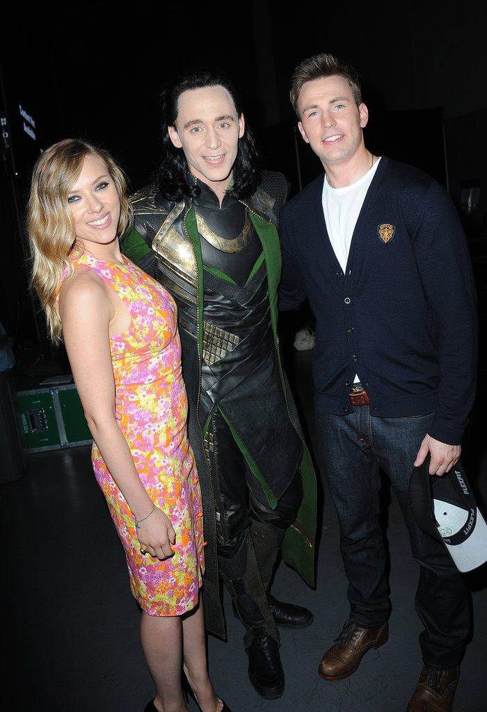 Scarlett Johansson posed with Tom Hiddleston and Chris Evans at Comic-Con.