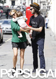Sienna Miller handed her daughter to Tom Sturridge.