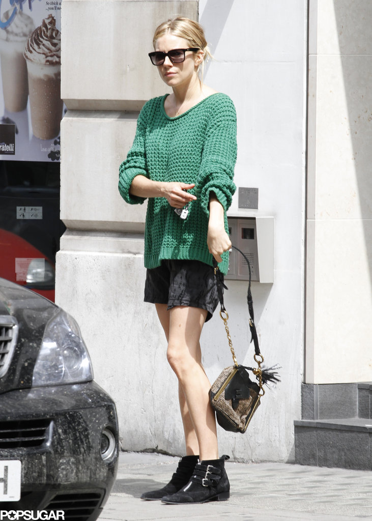 Sienna Miller wore a green sweater and shorts in London.