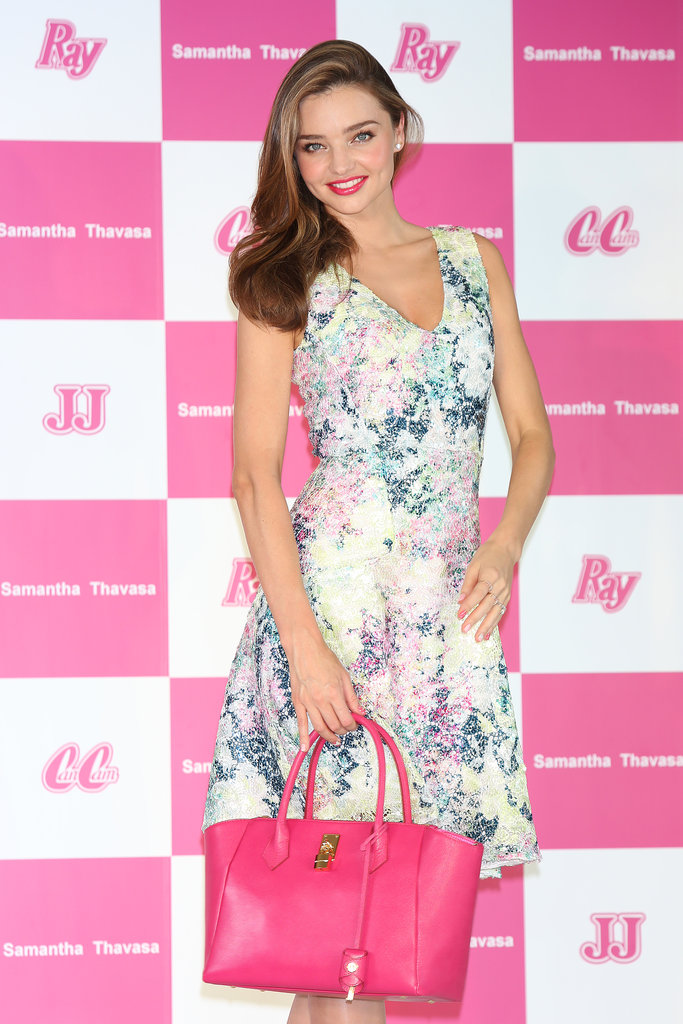 Miranda Kerr posed with a handbag.