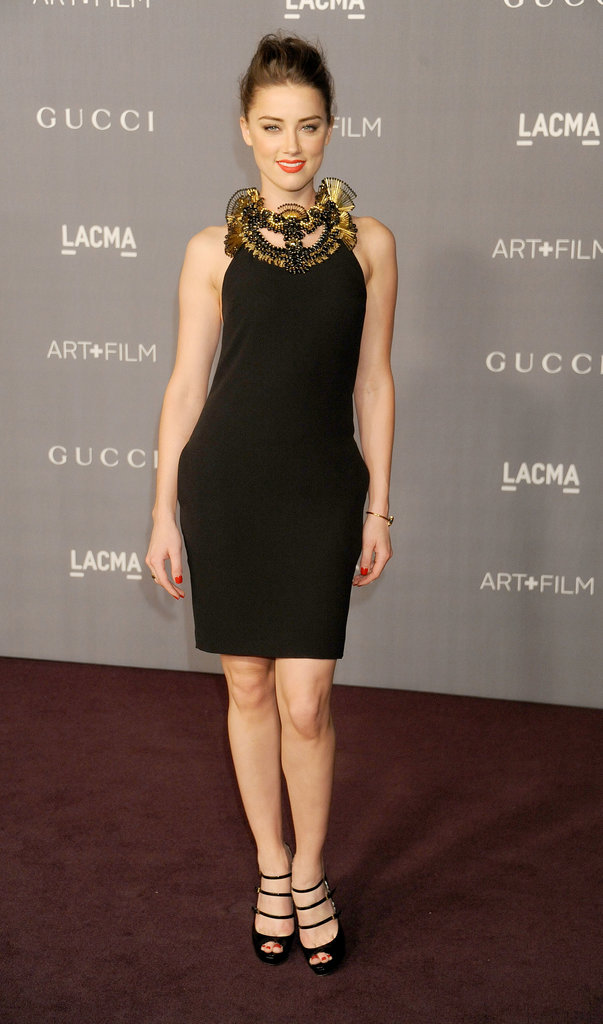 Even in a little black dress at a LACMA gala in October 2012, Amber was smoking.