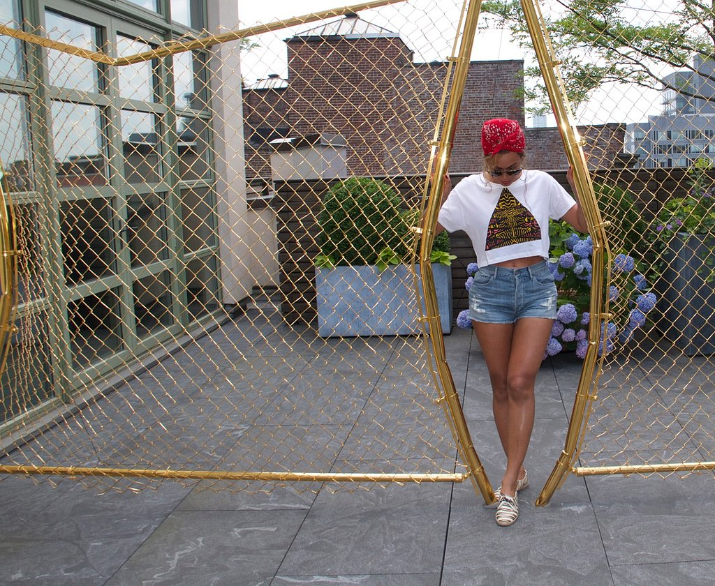 On another occasion, Beyoncé paired a Topshop cropped tee with denim cutoffs and striped espadrilles by Tabitha Simmons. Shop it: Tabitha Simmons striped flat espadrille sneakers ($177, originally $395) Source: Beyoncé on Tumblr