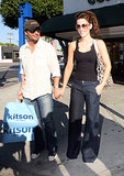 The actress balanced her wide-leg trousers with a fitted lace-trim black cami while shopping with her husband in 2007.